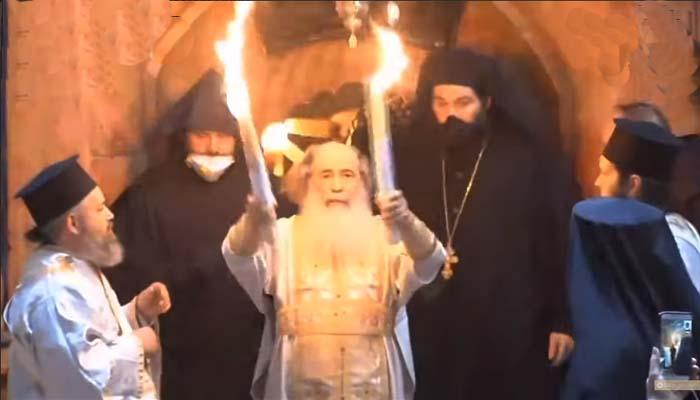 Ξεκίνησε το ταξιδι του Αγίου Φωτόςαπό τα Ιεροσόλυμα - Στις 18.00 φθάνει στην Ελλάδα [βίντεο από την τελετή]